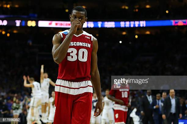 Vitto Brown of the Wisconsin Badgers walks off the court after being defeated by the Notre Dame Fighting Irish with a score of 56 to 61 during the...