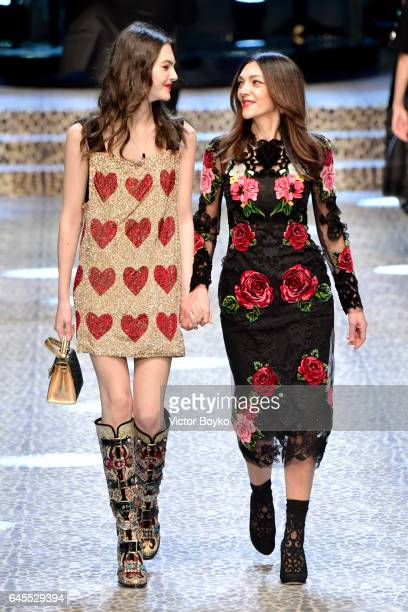 Vittoria Ceretti and Francesca Lazzari walk the runway at the Dolce Gabbana show during Milan Fashion Week Fall/Winter 2017/18 on February 26 2017 in...