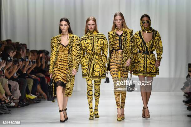Vittoria Ceretti and models walk the runway at the Versace show during Milan Fashion Week Spring/Summer 2018 on September 22 2017 in Milan Italy