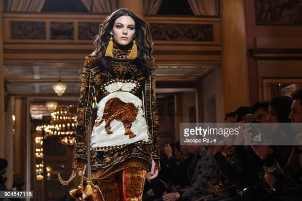 Vittoria Ceretti walks the runway at the Versace show during Milan Men's Fashion Week Fall/Winter 2018/19 on January 13 2018 in Milan Italy