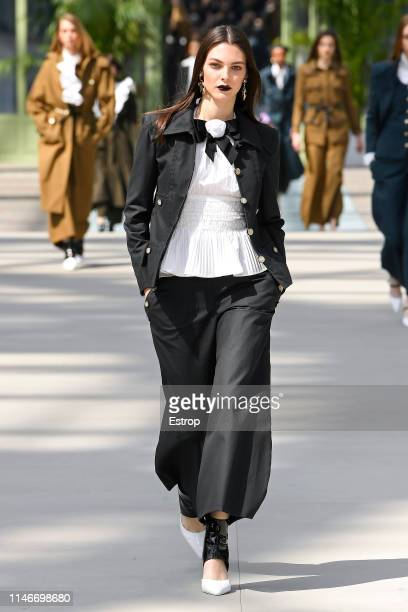 Vittoria Ceretti walks the runway during Chanel Cruise 2020 Collection at Le Grand Palais on May 3 2019 in Paris France