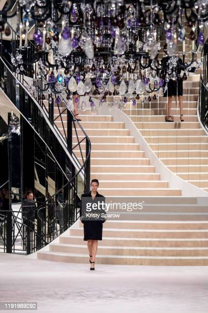 Vittoria Ceretti walks the runway during the Chanel Metiers d'Art 2019-2020 show at Le Grand Palais on December 04, 2019 in Paris, France.