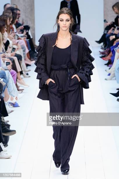 Vittoria Ceretti walks the runway during the Max Mara fashion show as part of Milan Fashion Week Fall/Winter 20202021 on February 20 2020 in Milan...