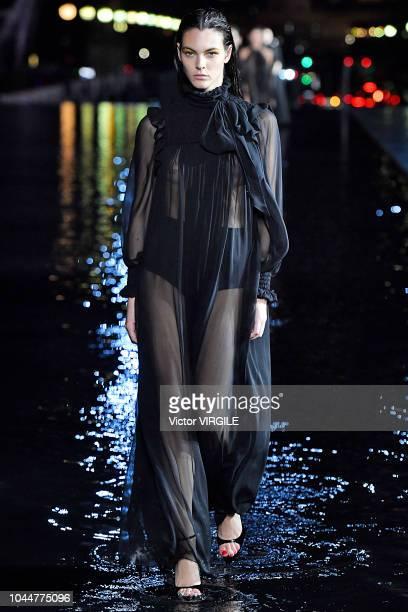 Vittoria Ceretti walks the runway during the Saint Laurent Ready to Wear fashion show as part of the Paris Fashion Week Womenswear Spring/Summer 2019...
