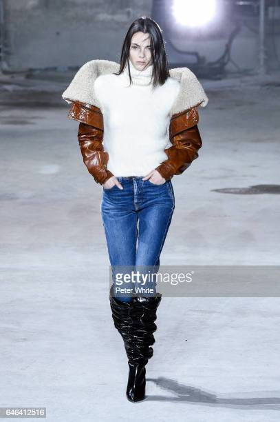 Vittoria Ceretti walks the runway during the Saint Laurent show as part of the Paris Fashion Week Womenswear Fall/Winter 2017/2018 on February 28...