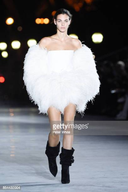 Vittoria Ceretti walks the runway during the Saint Laurent show as part of the Paris Fashion Week Womenswear Spring/Summer 2018 on September 26 2017...