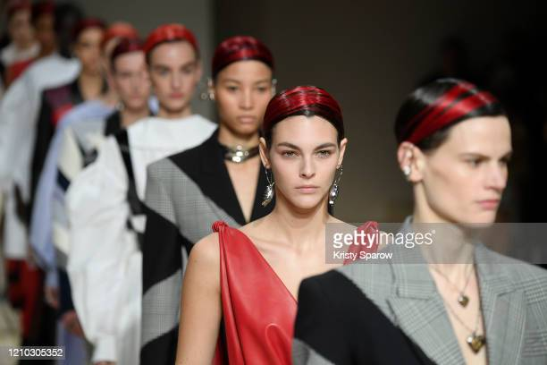 Vittoria Ceretti walks the runway with models during the Alexander McQueen show as part of Paris Fashion Week Womenswear Fall/Winter 2020/2021 on...