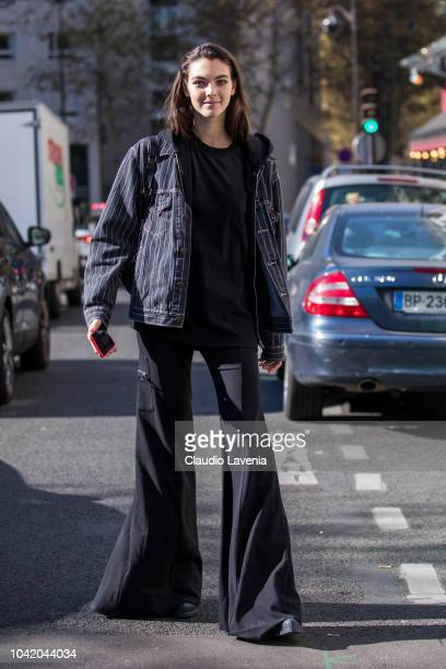 Vittoria Ceretti wearing a pinstripe jacket a black hoody and black pants is seen after the Chloe show on September 27 2018 in Paris France