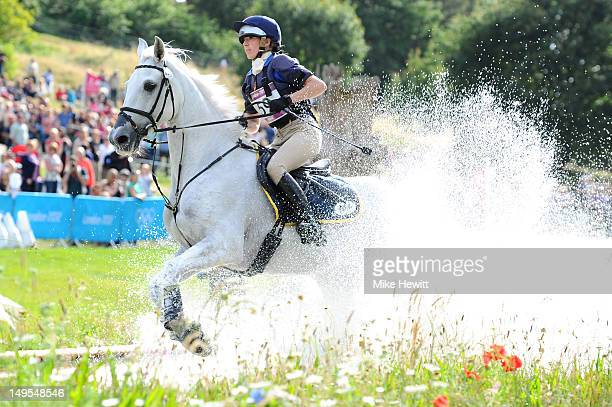 Vittoria Panizzon of Italy riding Borough Pennyz in the water in the Eventing Cross Country Equestrian event on Day 3 of the London 2012 Olympic...
