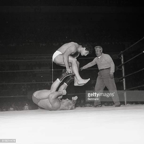 Vittorio Apollo takes a flying leap over the heels of Buddy Rodgers of Camden NJ during their wrestling match at Madison Square Garden March 27th...