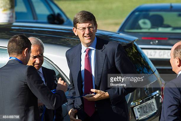 Vittorio Colao chief executive officer of Vodafone Group Plc center arrives for the opening session of the 28th Telecommunications and Digital...