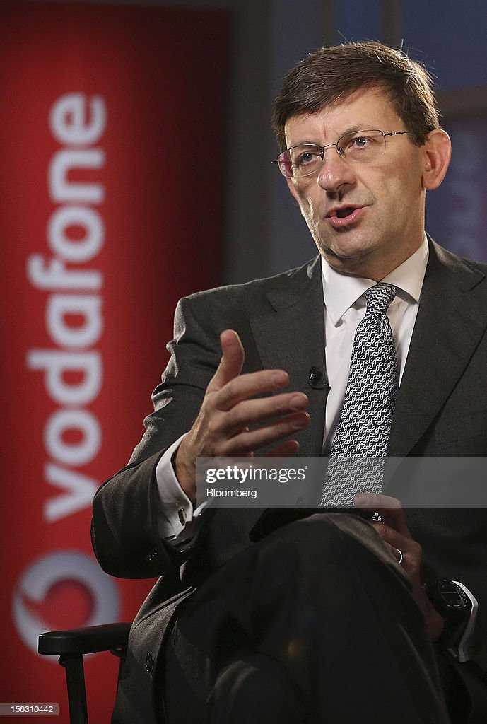 Vittorio Colao, chief executive officer of Vodafone Group Plc, gestures during a Bloomberg Television interview in London, U.K., on Tuesday, Nov. 13, 2012. Vodafone Group Plc, the second-largest mobile-phone company, reported service revenue that missed analysts' estimates and took a 5.9 billion pound ($9.4 billion) impairment writedown in Spain and Italy. Photographer: Simon Dawson/Bloomberg via Getty Images