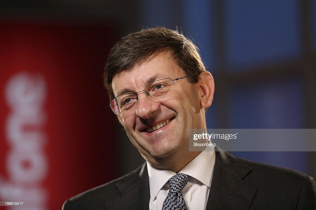 Vittorio Colao, chief executive officer of Vodafone Group Plc, smiles during a Bloomberg Television interview interview in London, U.K., on Tuesday, Nov. 13, 2012. Vodafone Group Plc, the second-largest mobile-phone company, reported service revenue that missed analysts' estimates and took a 5.9 billion pound ($9.4 billion) impairment writedown in Spain and Italy. Photographer: Simon Dawson/Bloomberg via Getty Images