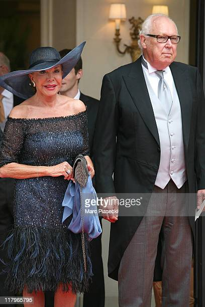 Vittorio Emanuele, Duke of Savoia, Prince of Naples and his wife Marina, princess of Naples leave the 'Hermitage' hotel to attend the religious...