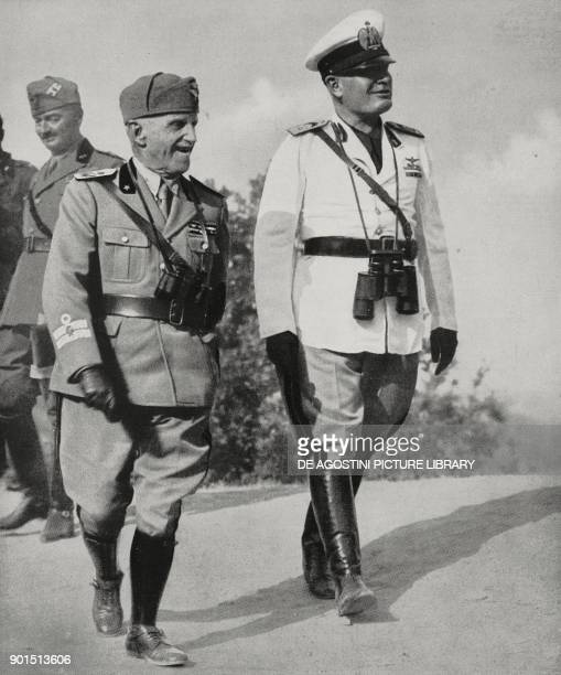Vittorio Emanuele III and Benito Mussolini on the way to the Monte Camiciola Observatory during experimental military exercises in Abruzzo, Italy,...