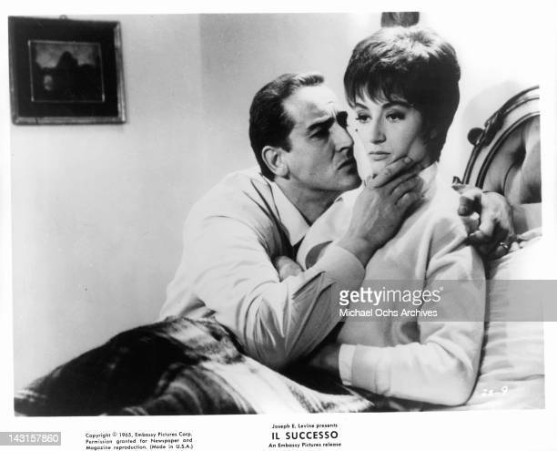 Vittorio Gassman affectionately holding Anouk Aimee's chin in a scene from the film 'Il Successo' 1965