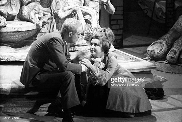 Vittorio Gassman and Ilaria Occhini are crouched down hand in hand and look intensely Teatro Lirico Milan November 23 1960