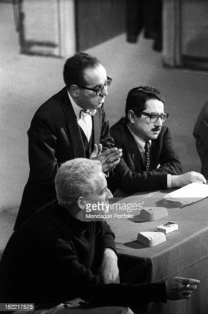 Vittorio Gassman Luciano Lucignano and Ennio Flaiano attend a forum with the spectators after the flop of the play 'Un marziano a Roma' Teatro Lirico...