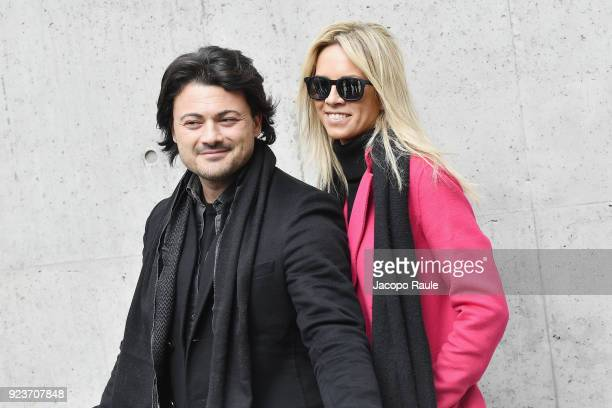 Vittorio Grigolo and guest attend the Giorgio Armani show during Milan Fashion Week Fall/Winter 2018/19 on February 24 2018 in Milan Italy