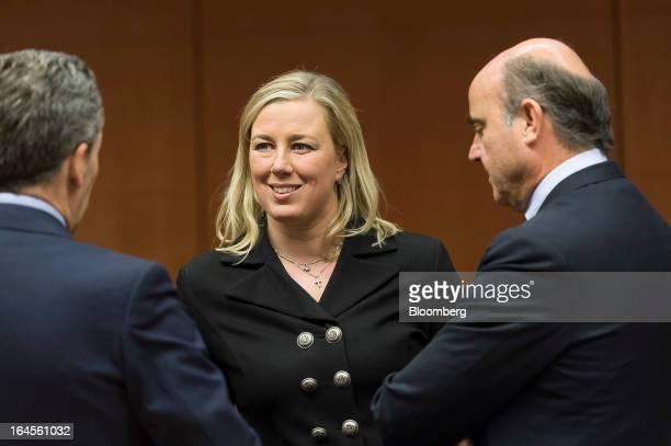 Vittorio Grilli Italy's finance minister left Jutta Urpilainen Finland's finance minister center and Pierre Moscovici France's finance minister speak...