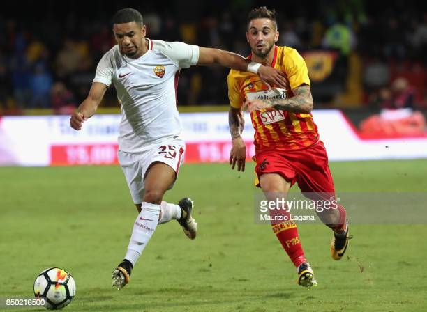Vittorio Parigini of Benevento competes for the ball with Bruno Peres of Roma during the Serie A match between Benevento Calcio and AS Roma at Stadio...