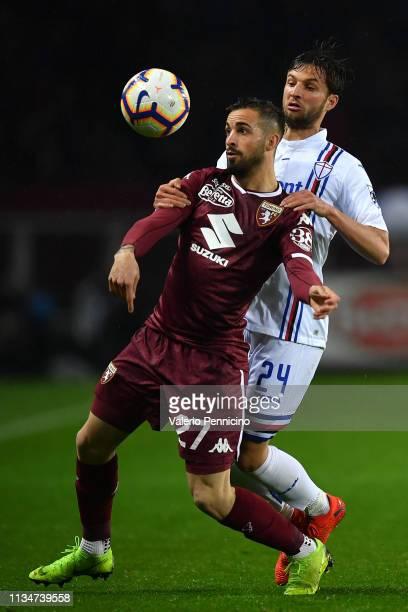 Vittorio Parigini of Torino FC is challenged by Bartosz Bereszynski of UC Sampdoria during the Serie A match between Torino FC and UC Sampdoria at...