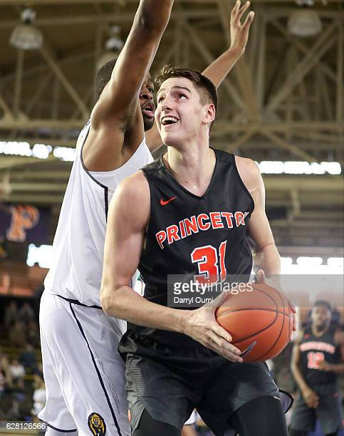 Vittorio ReynosoAvila of the Princeton Tigers looks to shoot while being guarded by Kingsley Okoroh of the California Golden Bears during the first...