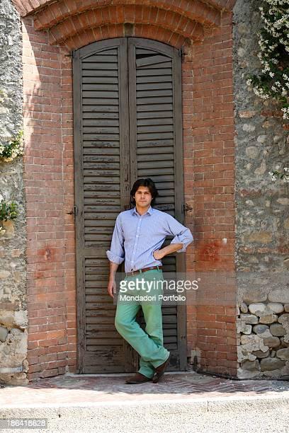 Vittorio Sgarbi's son Carlo Sgarbi Brenner leaning against a shutter of Villa Banfi. Vimercate, 2000s.