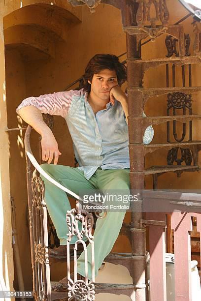 Vittorio Sgarbi's son Carlo Sgarbi Brenner sitting on a winding staircase of Villa Banfi. Vimercate, 2000s.