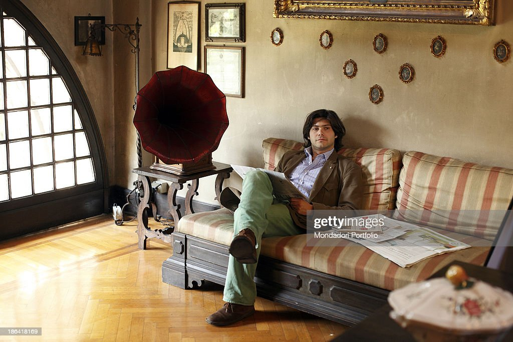 Carlo Sgarbi Brenner seated in a couch : News Photo