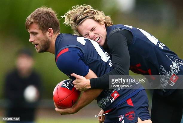 Viv Michie of the Demons is tackled by Jayden Hunt of the Demons during a Melbourne Demons AFL training session at Gosch's Paddock on June 17 2016 in...