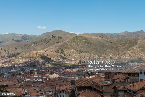 viva el perù written on the top of a cuzco hill - utc−10:00 stock pictures, royalty-free photos & images
