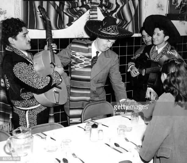 "Viva Wallace"" cheers rang through the narrow La Bonita restaurant at 2112 Larimer street Sunday night where presidential candidate Henry A. Wallace..."