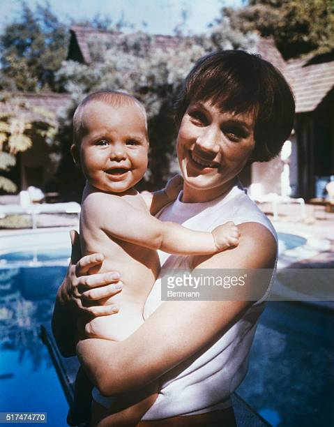 Vivacious Julie Andrews in private life Mrs Tony Walton poses for an informal portrait with her infant daughter Emma Kate Walton during a day off...