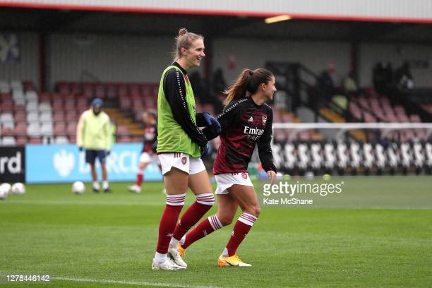 Vivanne Miedema and Danielle Van de Donk of Arsenal FC laugh prior to the Barclays FA Women's Super League match between Arsenal and Bristol City at...