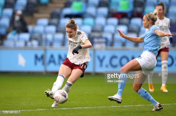 Vivanne Miedema of Arsenal FC scores their team's first goal past Steph Houghton of Manchester City during the Barclays FA Women's Super League match...