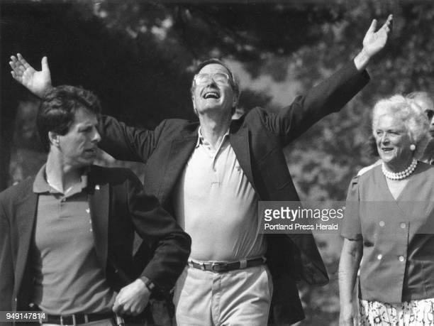 Vive President George HW Bush basks in the warmth of the sun and teh applause given him as he enters the grounds of the Franciscan Monastery in...