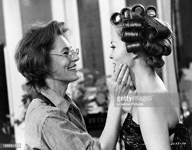 Viveca Lindfors applies makeup to Faye Dunaway in a scene from the film 'Puzzle Of A Downfall Child' 1970
