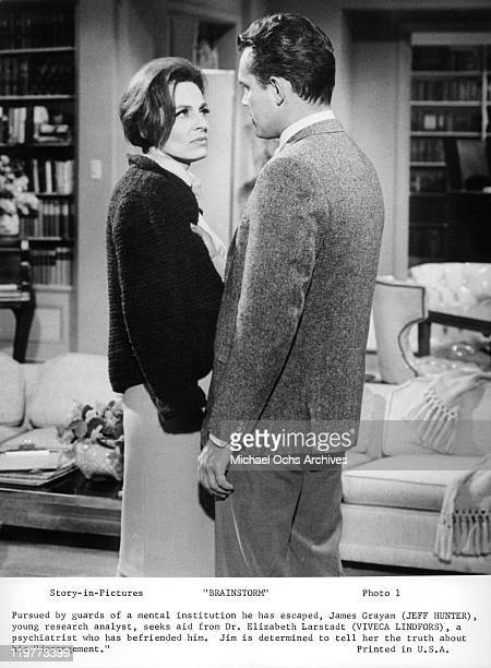 Viveca Lindfors listens to Jeffrey Hunter in a scene from the film 'Brainstorm' 1965