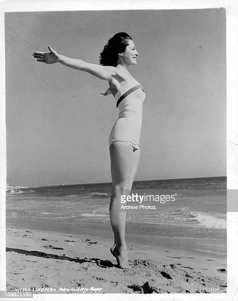 Viveca Lindfors on beach in publicity portrait circa 1955