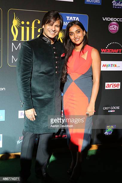 Vivek Oberoi and Priyanka Alva Oberoi arrive to the IIFA Magic of the Movies at MIDFLORIDA Credit Union Amphitheatre on April 25 2014 in Tampa Florida