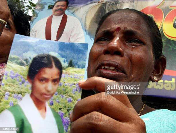 Vivekanadam Jayalingeshwari 38 a relative of a detained Tamil Tiger rebel suspect cries as she holds a photo of her daughter during a protest outside...