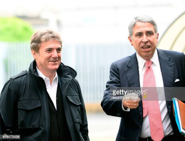 Vivendi's Chairman of the Supervisory Board, Arnaud de Puyfontaine and Telecom Italia CEO's Flavio Cattaneo arrive at the General meeting of...