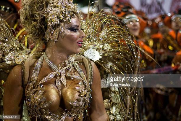 Vivian Araujo of Salgueiro dances during the samba school's parade group A at Rio de Janeiro's carnival on February 21 2012 in Rio de Janeiro Brazil...