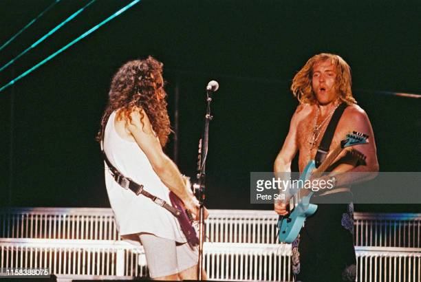 Vivian Campbell and Phil Collen of Def Leppard perform on stage at The Don Valley Stadium on June 6th 1993 in Sheffield England