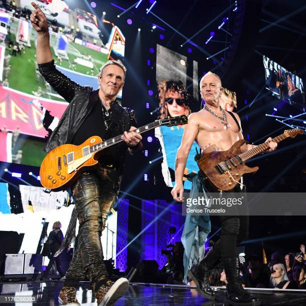 Vivian Campbell and Phil Collen of Def Leppard perform onstage during the 2019 iHeartRadio Music Festival at T-Mobile Arena on September 21, 2019 in...