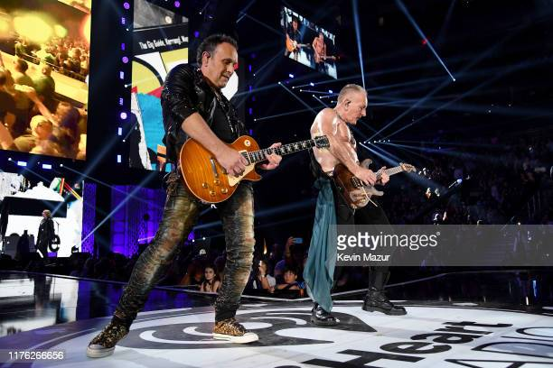 Vivian Campbell and Phil Collen of Def Leppard perform onstage during the 2019 iHeartRadio Music Festival at TMobile Arena on September 21 2019 in...