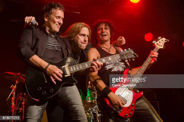 Vivian Campbell Andrew Freeman and Phil Soussan of Last inLine perform onstage at the NI Music Awards at Mandela Hall on November 11 2017 in Belfast...
