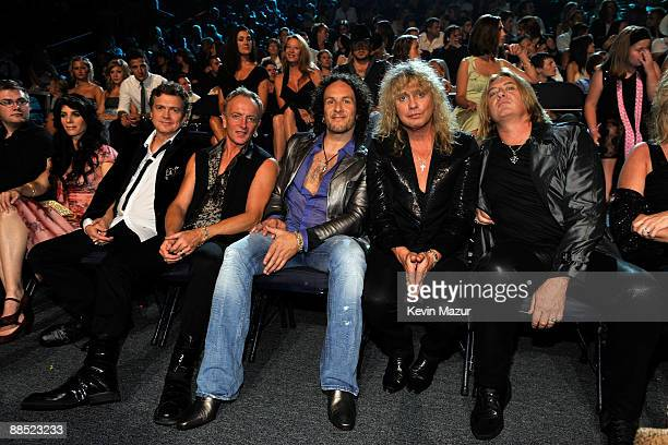Vivian Campbell, Joe Elliott, Rick Savage, Phil Collen, and Rick Allen of Def Leppard attend the 2009 CMT Music Awards at the Sommet Center on June...