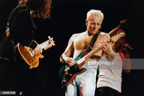 Vivian Campbell Phil Collen and Joe Elliott of Def Leppard perform on stage at the Birmingham NEC on October 16th 1996 in Birmingham England